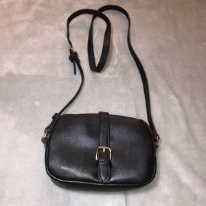 Small black purse with gold detailing